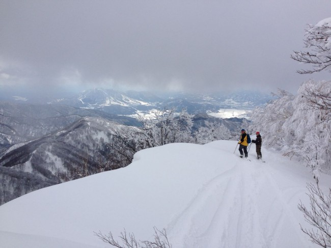Clouds lifting to reveal sun and snow in Nozawa