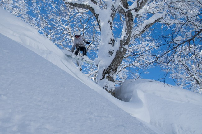 The rewards if skiing Japan in March. Kelsey getting some air time.