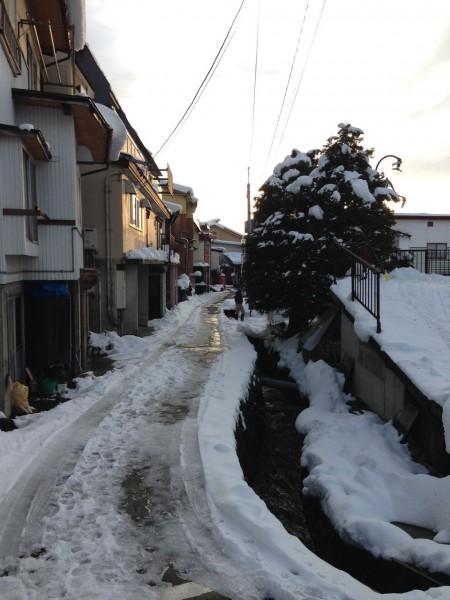 Sunset, small street , snow shovel Nozawa Style