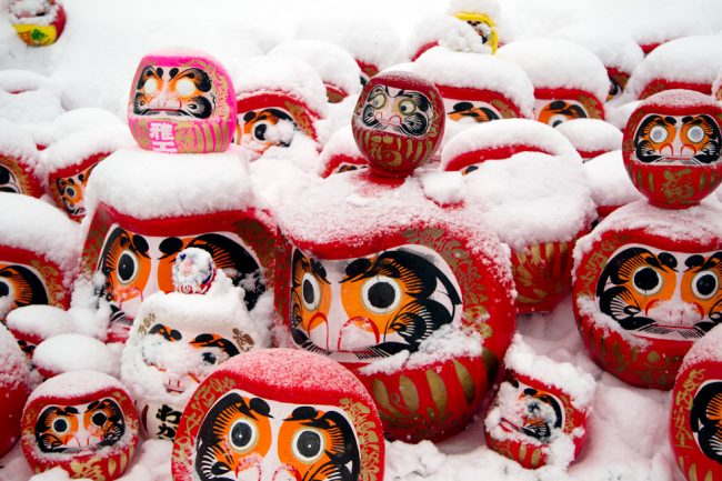The Daruma which both eyes are coloured black when a wish comes true are burnt at the Fire Festival in Nozawa