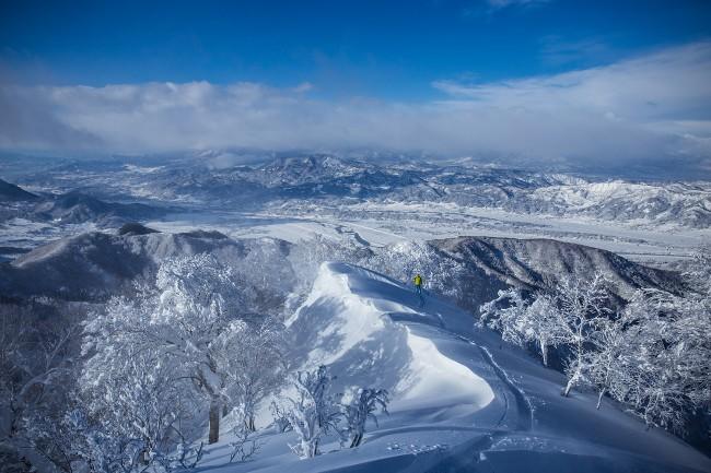 Lubo traverses a high ridge line near Nozawa Onsen.