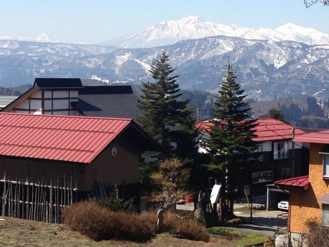 Looking over Kaiya Nozawa Lodge to Mt Myoko and Hiuchi in the back ground in Nozawa