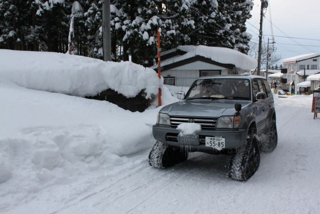 These guys will deliver anywhere, anytime the Black Cat delivery service on the snow in Nozawa near Mt Dock