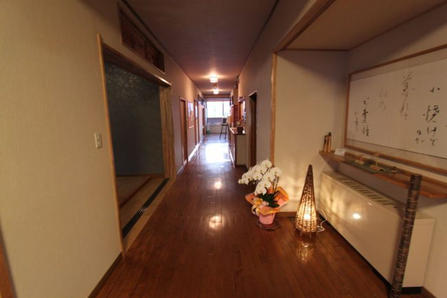 The entrance to Maruji lodge in Nozawa where you are always assured a warm welcome
