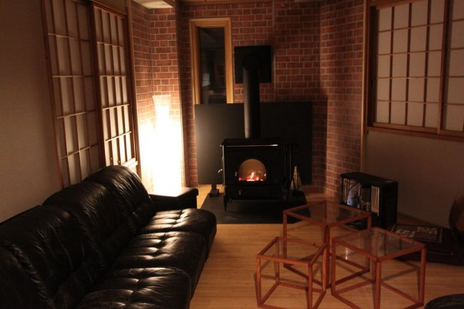 Cosy communal areas with a warming fireplace at Lodge Nagano